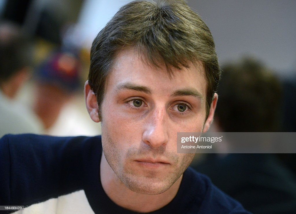 French skating champion <a gi-track='captionPersonalityLinkClicked' href=/galleries/search?phrase=Brian+Joubert&family=editorial&specificpeople=213858 ng-click='$event.stopPropagation()'>Brian Joubert</a> pauses before a press conference to announce the French flag bearer for the Sochi 2014 Winter Olympics was unveiled on October 14, 2013 in Paris, France.