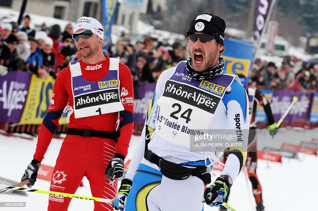 French skier Adrien Mougel (R) celebrates as he crosses the finish line of the 35th 'Foulee blanche' (White stride) 42km cross country skiing race on January 27, 2013 in Autrans, French Alps. Mougel won the event ahead of his compatriots Yvan Perrillat Boitteux and Benoit Chauvet.