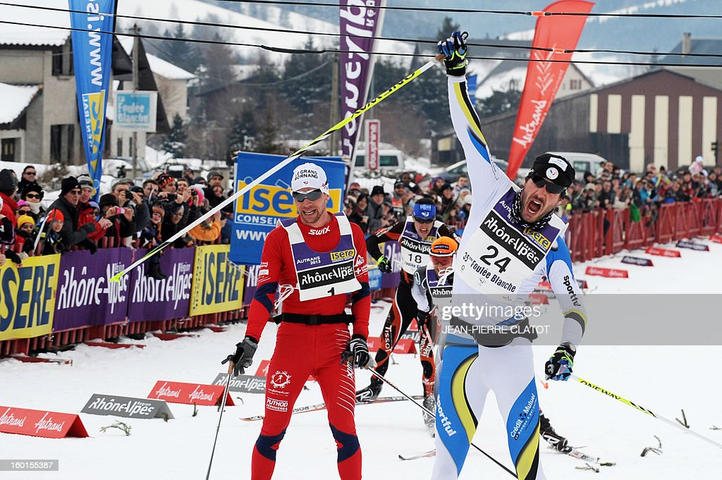 French skier Adrien Mougel (R) celebrates as he crosses the finish line of the 35th 'Foulee blanche' (White stride) 42km cross country skiing race on January 27, 2013 in Autrans, French Alps. Mougel won the event ahead of his compatriots Yvan Perrillat Boitteux and Benoit Chauvet. AFP PHOTO / JEAN-PIERRE CLATOT