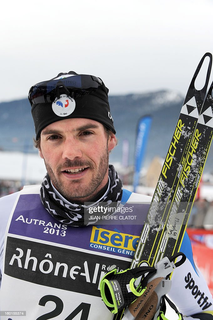 French skier Adrien Mougel poses after winning the 35th 'Foulee blanche' (White stride) 42km cross country skiing race on January 27, 2013 in Autrans, French Alps. Mougel won the event ahead of his compatriots Yvan Perrillat Boitteux and Benoit Chauvet. AFP PHOTO / JEAN-PIERRE CLATOT