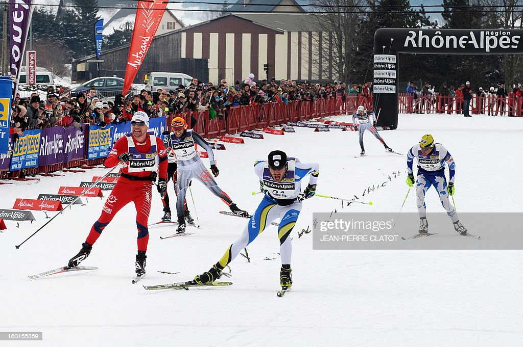 French skier Adrien Mougel (C) reacts as he crosses the finish line of the 35th 'Foulee blanche' (White stride) 42km cross country skiing race on January 27, 2013 in Autrans, French Alps. Mougel won the event ahead of his compatriots Yvan Perrillat Boitteux and Benoit Chauvet.