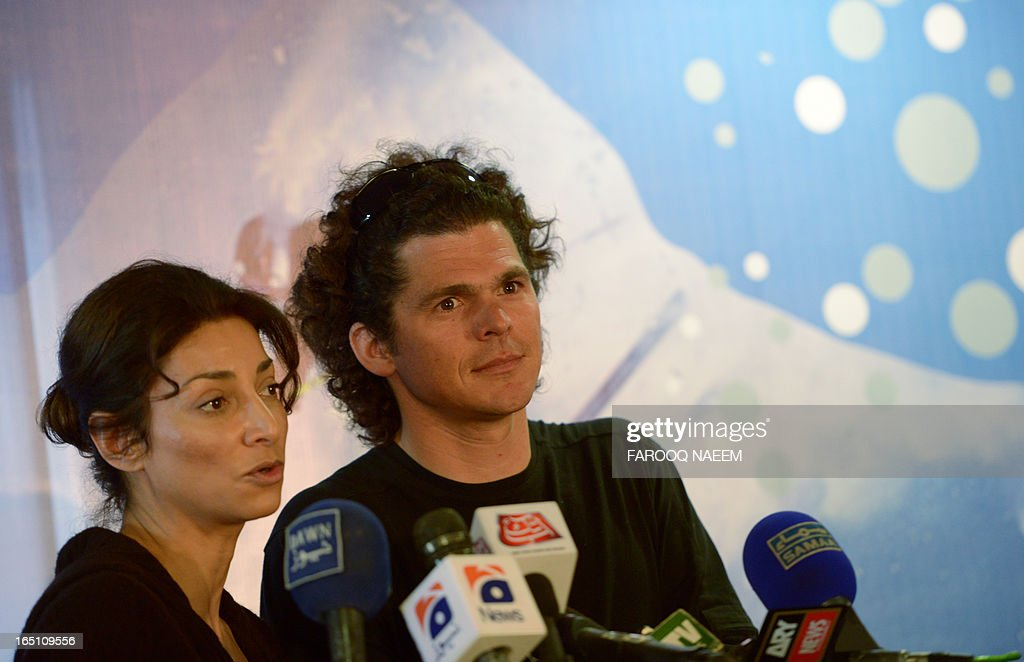 French skier Brice Lequertier (R), who leads the world's top skiers team, and Samyra Rashid (L) of Pakistan speaks during a briefing at the Benazir Bhutto International Airport in Islamabad on March 30, 2013. An eleven-member team of world's top skiers arrived here today to participate in the week-long heli-skiing event 'Pakistan Pure Discovery' in Skardu. The event is organized by the Inter Services Public Relations (ISPR) in collaboration with Walkabout Films, the only film production company of the country focused on extreme sports events, wildlife and natural heritage. AFP PHOTO/Farooq NAEEM