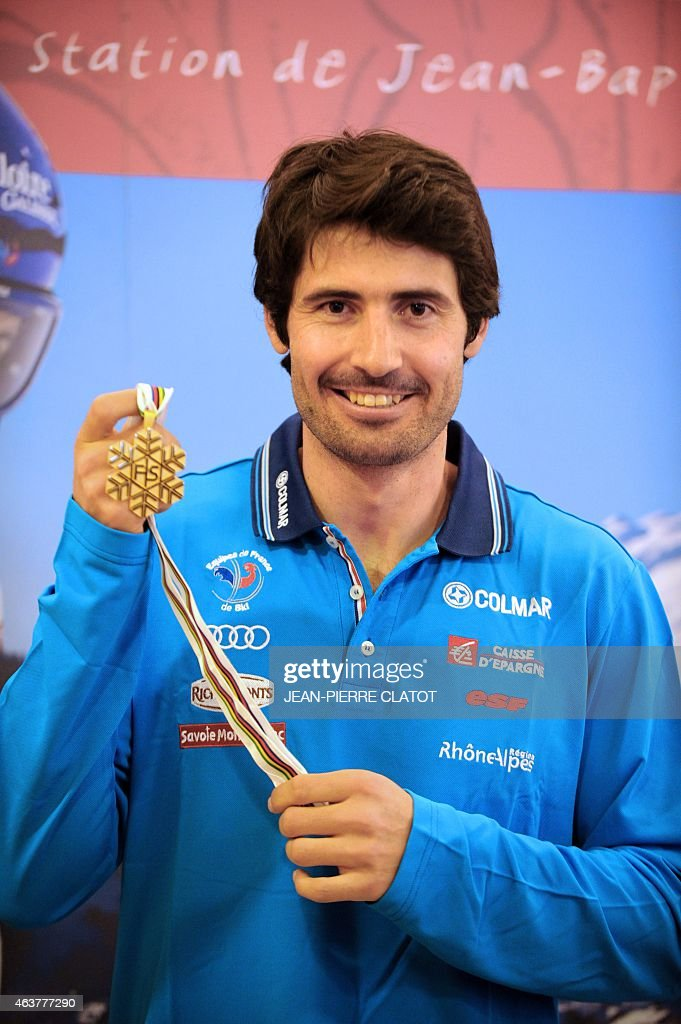 French skier <a gi-track='captionPersonalityLinkClicked' href=/galleries/search?phrase=Jean-Baptiste+Grange&family=editorial&specificpeople=807801 ng-click='$event.stopPropagation()'>Jean-Baptiste Grange</a> poses with his Gold medal, on February 18, 2015 in Valloire, upon his return home from the Alpine skiing World Championship where he won gold in the men's Slalom event in Beaver Creek, USA. AFP PHOTO / Jean-Pierre Clatot
