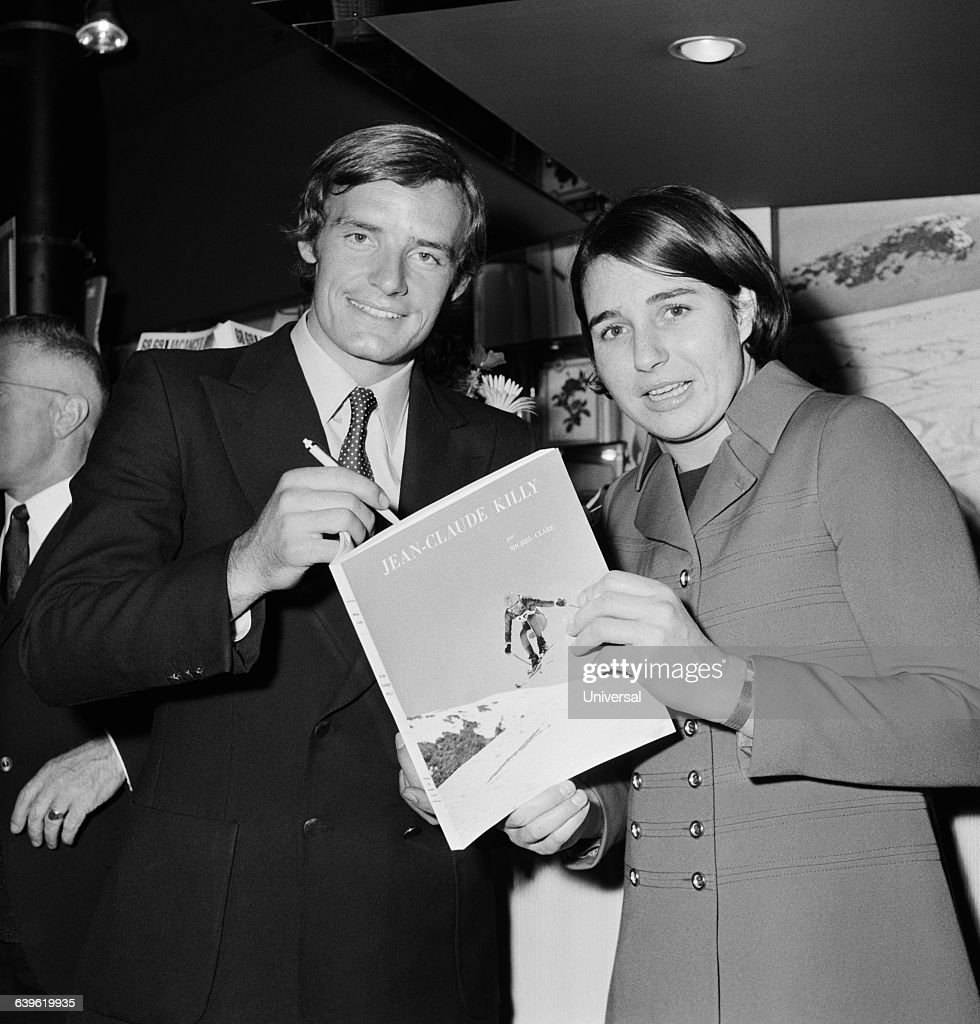 French skier <a gi-track='captionPersonalityLinkClicked' href=/galleries/search?phrase=Jean-Claude+Killy&family=editorial&specificpeople=223880 ng-click='$event.stopPropagation()'>Jean-Claude Killy</a> signing a book about him for Marielle Goitschel.