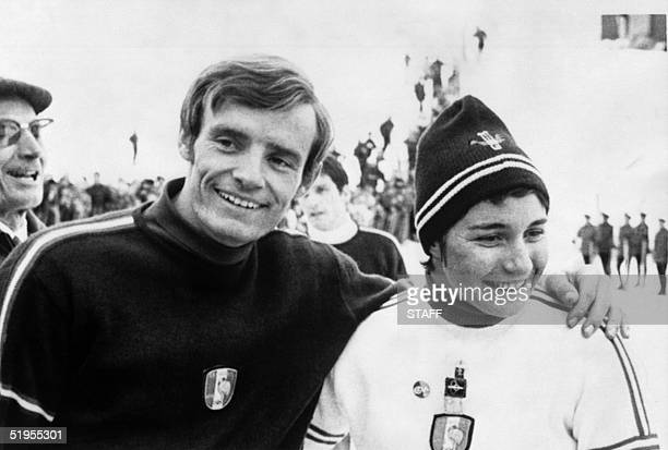 French skier JeanClaude Killy smiles as he poses with compatriot Marielle Goitschel 14 February 1968 in Grenoble during the Winter Olympic Games...
