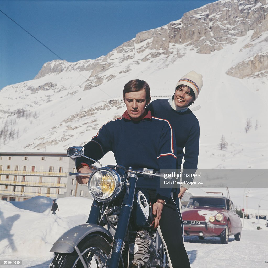 French skiers Annie Famose and <a gi-track='captionPersonalityLinkClicked' href=/galleries/search?phrase=Jean-Claude+Killy&family=editorial&specificpeople=223880 ng-click='$event.stopPropagation()'>Jean-Claude Killy</a> pictured together riding a motorbike in the French Alps on 17th December 1967.