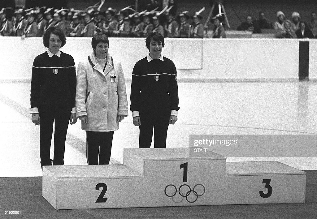 French skiers Christine Goitschel (L) and her younger sister Marielle (R) stand next to Jean Saubert of the USA during the women's giant slalom medals ceremony 03 February 1964 at the Winter Olympic Games in Innsbruck. Marielle Goitschel won the gold medal as her sister and Saubert finished tied for second to capture the silver medal. Two days earlier, Christine had won the gold medal in the slalom in front of Marielle (silver medal) and Saubert (bronze).
