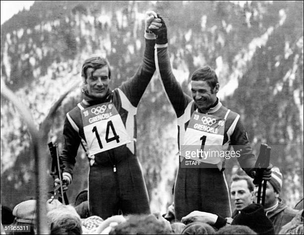 French skiers JeanClaude Killy and Guy Perillat celebrate after winning the gold and the silver medal in the men's downhill event 09 February 1968 in...