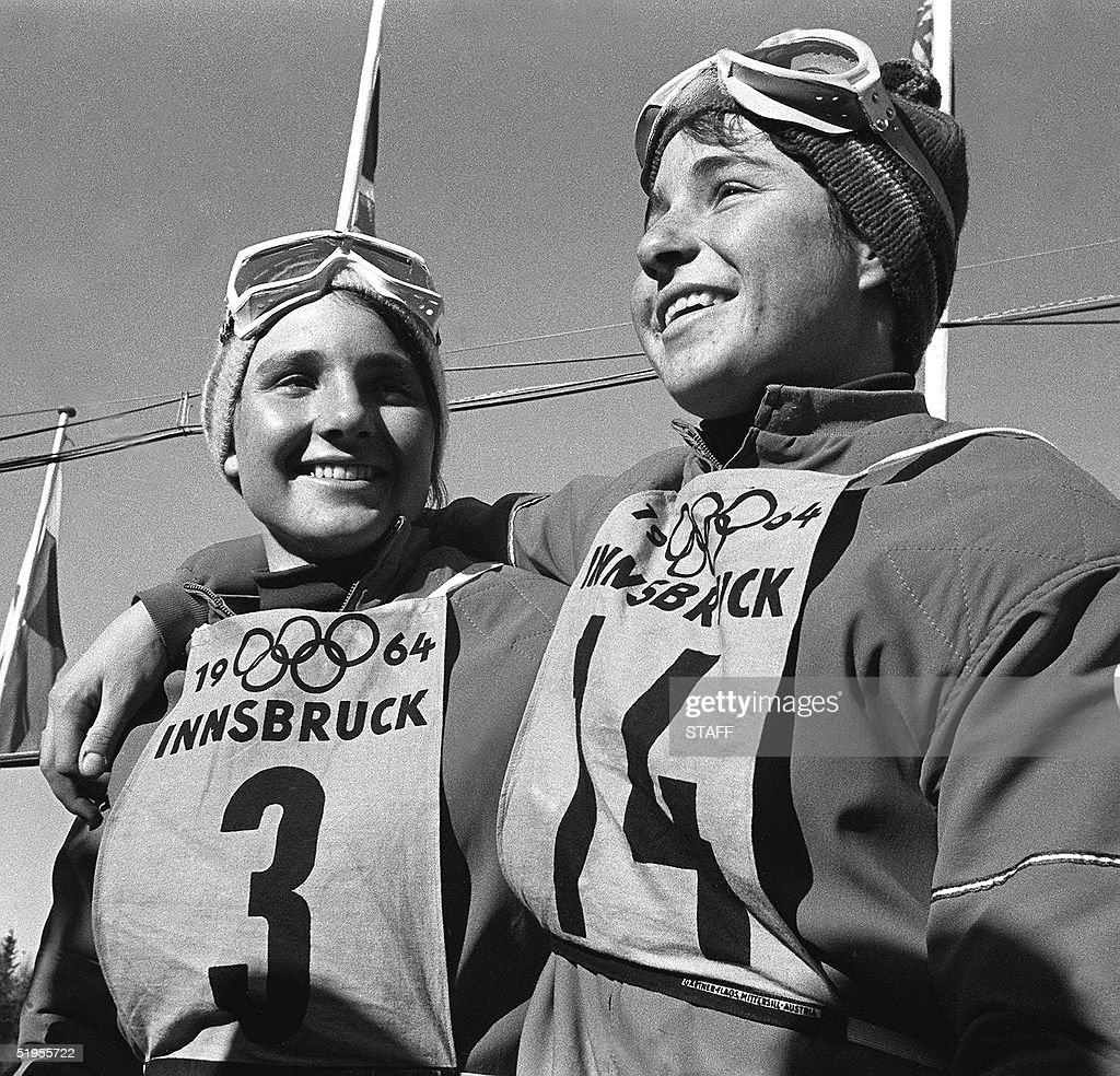French skiers Marielle Goitschel (R) and her older sister Christine smile 03 February 1964 in Innsbruck after winning the gold and silver medals in the women's giant slalom at the Winter Olympic Games. Two days earlier, it was the other way around, in the slalom, with Christine winning the gold and Marielle, the silver.