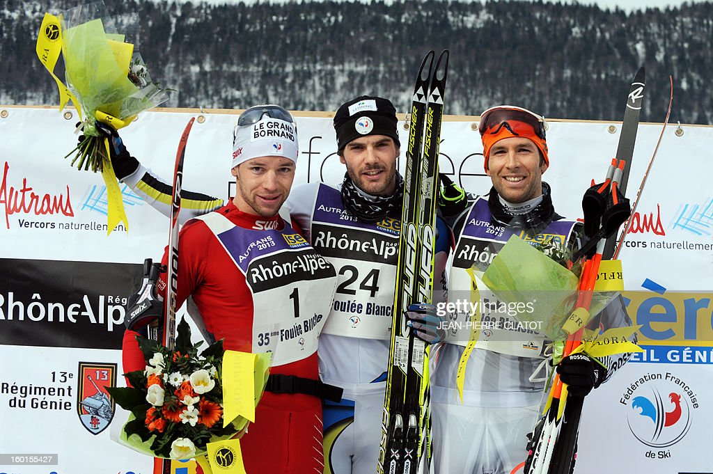 French skiers Yvan Perillat Boitteux, Adrien Mougel and Benoit Chauvet pose on the podium at the end of the 35th 'Foulee blanche' (White stride) 42km cross country skiing race on January 27, 2013 in Autrans, French Alps. Mougel won the event ahead of Perrillat-Boitteux (second) and Chauvet (third). AFP PHOTO / Jean Pierre Clatot