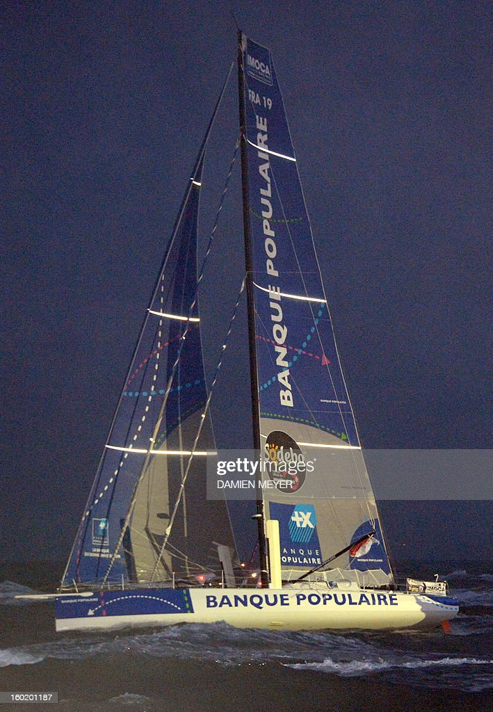French skipper Armel Le Cleach arrives on his monohull 'Banque Populaire' after crossing the finish line of the 7th edition of the Vendee Globe solo round-the-world race on January 27, 2013 off the coasts of Les Sables d'Olonne, western France. France's Francois Gabart, 29, set a new record with 78 days 02 h and 16 min, beating the previous record time set at 84 days 3hr 9min by 2009 winner Michel Desjoyeaux, and Le Cleach placed second.
