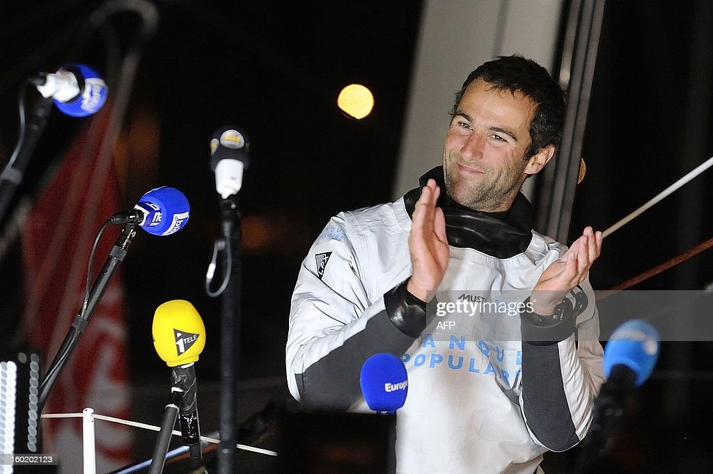 French skipper Armel Le Cleac'h celebrates aboard his monohull 'Banque Populaire' following journalists' questions as he finished second of the 7th edition of the Vendee Globe solo round-the-world race on January 27, 2013 in Les Sables d'Olonne, western France. AFP PHOTO / JEAN-SEBASTIEN EVRARD