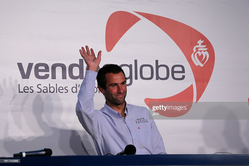 French skipper Armel Le Cleach celebrates at the end of the 7th edition of the Vendee Globe solo round-the-world race on January 27, 2013 off the coasts of Les Sables d'Olonne, western France. France's Francois Gabart, 29, set a new record with 78 days 02 h and 16 min, beating the previous record time set at 84 days 3hr 9min by 2009 winner Michel Desjoyeaux, and Le Cleach placed second PHOTO