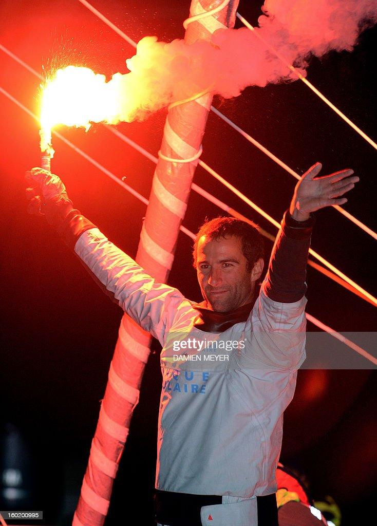 French skipper Armel Le Cleach celebrates on his boat 'Banque Populaire' after crossing the finish line of the 7th edition of the Vendee Globe solo round-the-world race on January 27, 2013 off the coasts of Les Sables d'Olonne, western France. France's Francois Gabart, 29, set a new record with 78 days 02 h and 16 min, beating the previous record time set at 84 days 3hr 9min by 2009 winner Michel Desjoyeaux, and Le Cleach placed second.