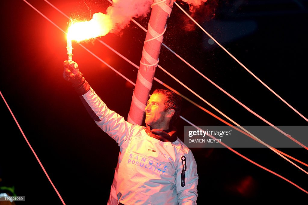 French skipper Armel Le Cleach celebrates on his boat 'Banque Populaire' after crossing the finish line of the 7th edition of the Vendee Globe solo round-the-world race on January 27, 2013 off the coasts of Les Sables d'Olonne, western France. France's Francois Gabart, 29, set a new record with 78 days 02 h and 16 min, beating the previous record time set at 84 days 3hr 9min by 2009 winner Michel Desjoyeaux, and Le Cleach placed second. AFP PHOTO DAMIEN MEYER