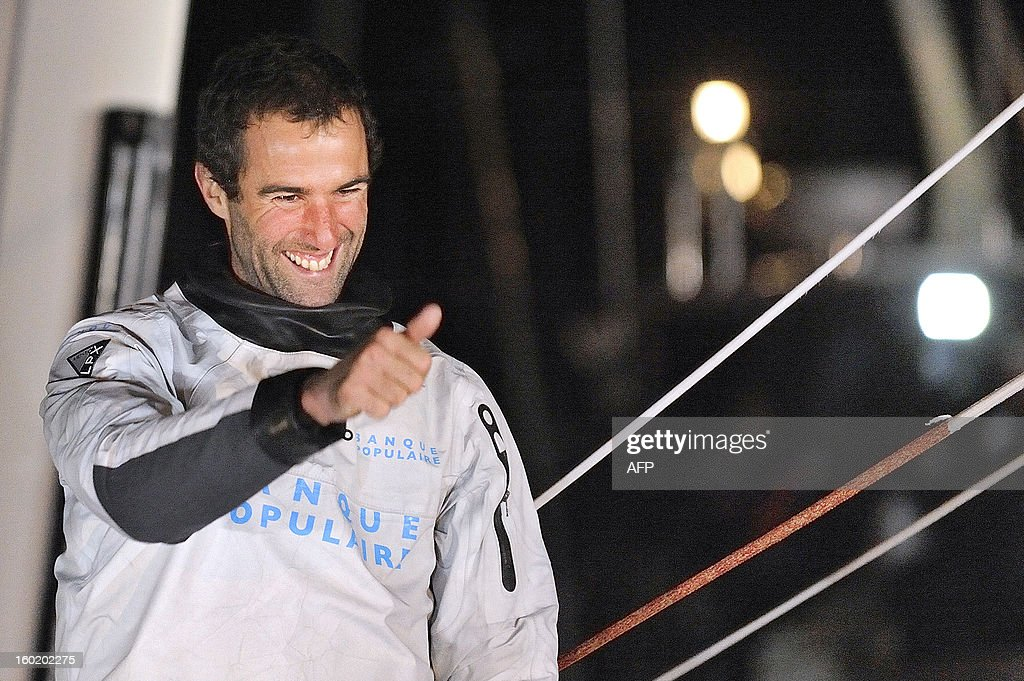French skipper Armel Le Cleac'h celebrates, thumbs up, aboard his monohull 'Banque Populaire' as he finished second of the 7th edition of the Vendee Globe solo round-the-world race on January 27, 2013 in Les Sables d'Olonne, western France.