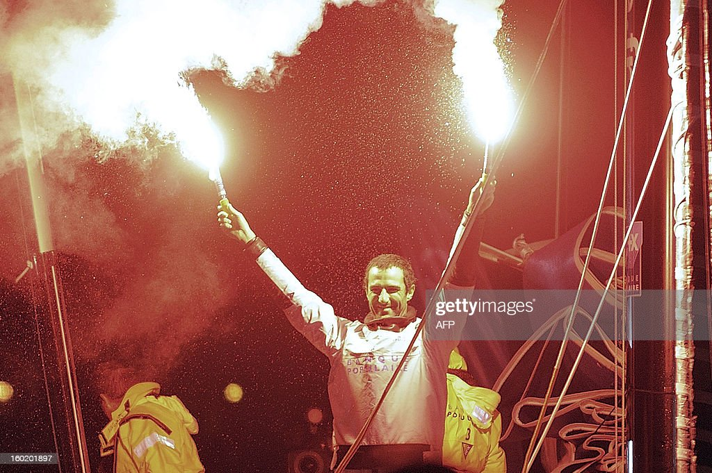 French skipper Armel Le Cleac'h celebrates with champagne aboard his monohull 'Banque Populaire' while he finished second of the 7th edition of the Vendee Globe solo round-the-world race on January 27, 2013 in Les Sables d'Olonne, western France.