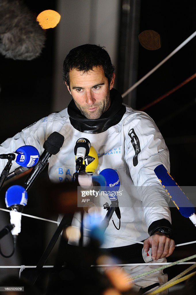 French skipper Armel Le Cleac'h speaks to journalists aboard his monohull 'Banque Populaire' after he finished second of the 7th edition of the Vendee Globe solo round-the-world race on January 27, 2013 in Les Sables d'Olonne, western France.