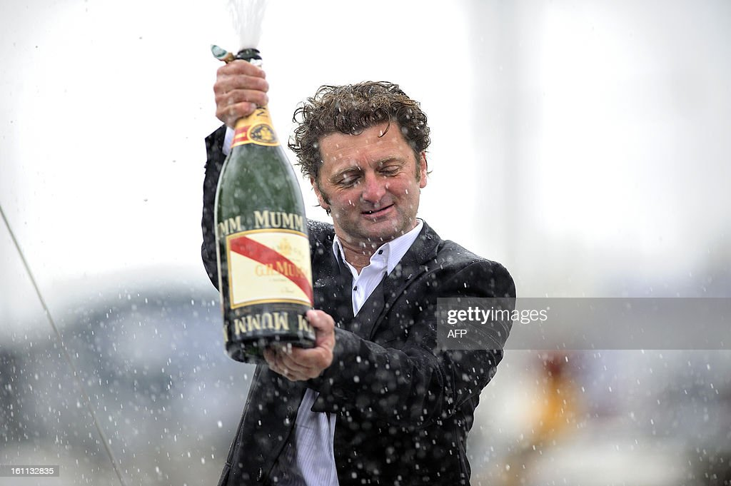 French skipper Arnaud Boissieres celebrates as he celebrates on his monohull 'Akena Verandas' as he finished eighth in the 7th edition of the Vendee Globe solo round-the-world race on February 9, 2013 in Les Sables d'Olonne, western France.