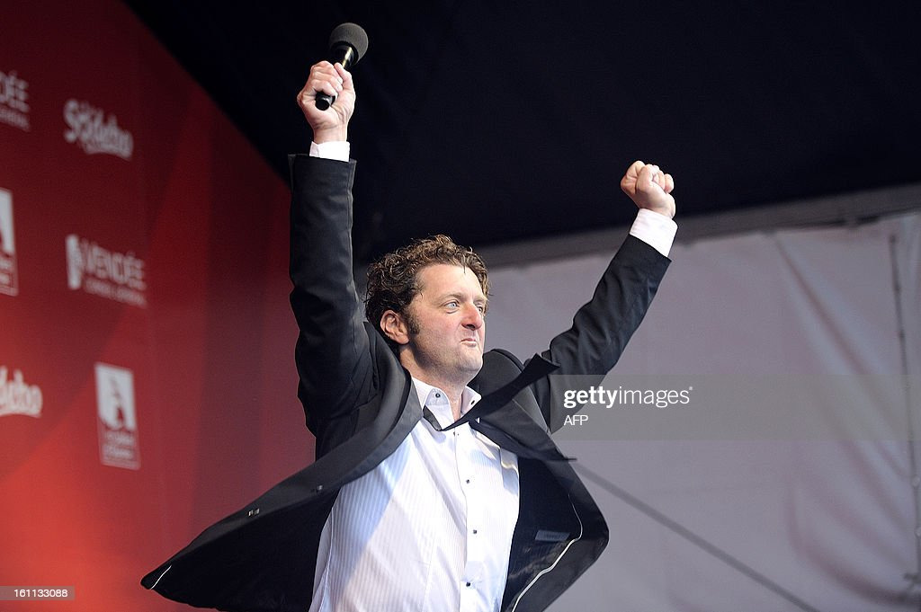 French skipper Arnaud Boissieres celebrates as he finished eighth in the 7th edition of the Vendee Globe solo round-the-world race on February 09, 2013 in Les Sables d'Olonne, western France.