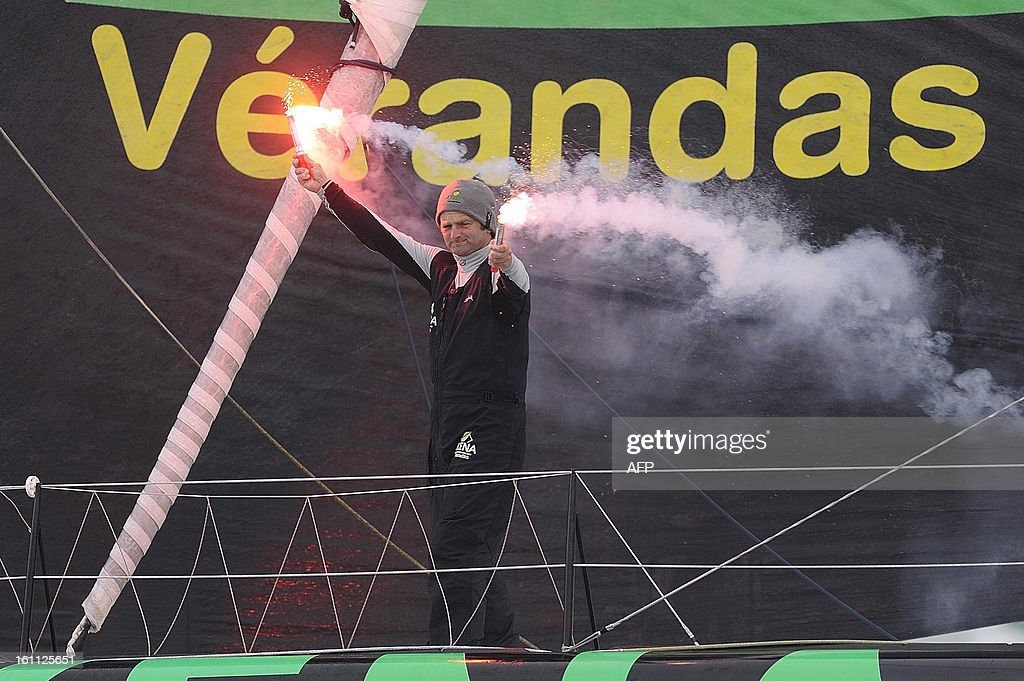 French skipper Arnaud Boissieres celebrates on his monohull 'Akena Verandas' as he finished eighth of the 7th edition of the Vendee Globe solo round-the-world race on February 9, 2013 in Les Sables d'Olonne, western France.