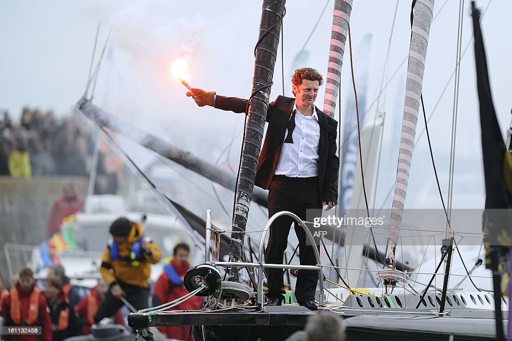 French skipper Arnaud Boissieres celebrates on his monohull 'Akena Verandas' as he finished eighth of the 7th edition of the Vendee Globe solo round-the-world race on February 9, 2013 in Les Sables d'Olonne, western France. AFP PHOTO JEAN-SEBASTIEN EVRARD