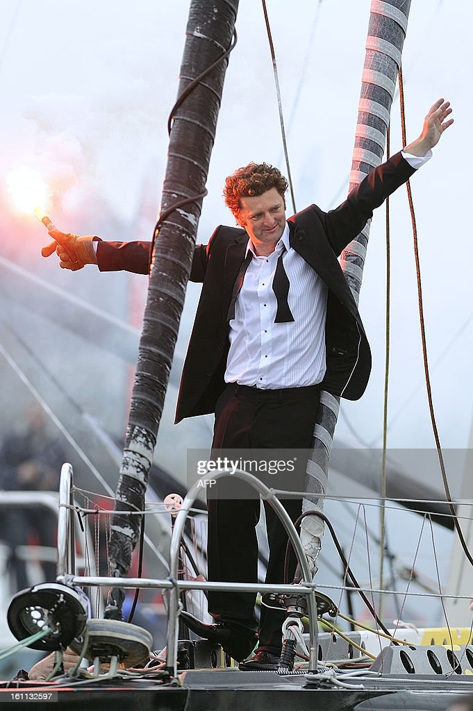 French skipper Arnaud Boissieres celebrates on his monohull 'Akena Verandas' as he finished eighth in the 7th edition of the Vendee Globe solo round-the-world race on February 9, 2013 in Les Sables d'Olonne, western France.