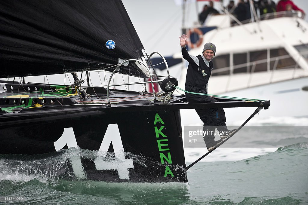 French skipper Arnaud Boissieres celebrates on his monohull 'Akena Verandas' as he finished eighth in the 7th edition of the Vendee Globe solo round-the-world race on February 9, 2013 in Les Sables-d'Olonne, western France.
