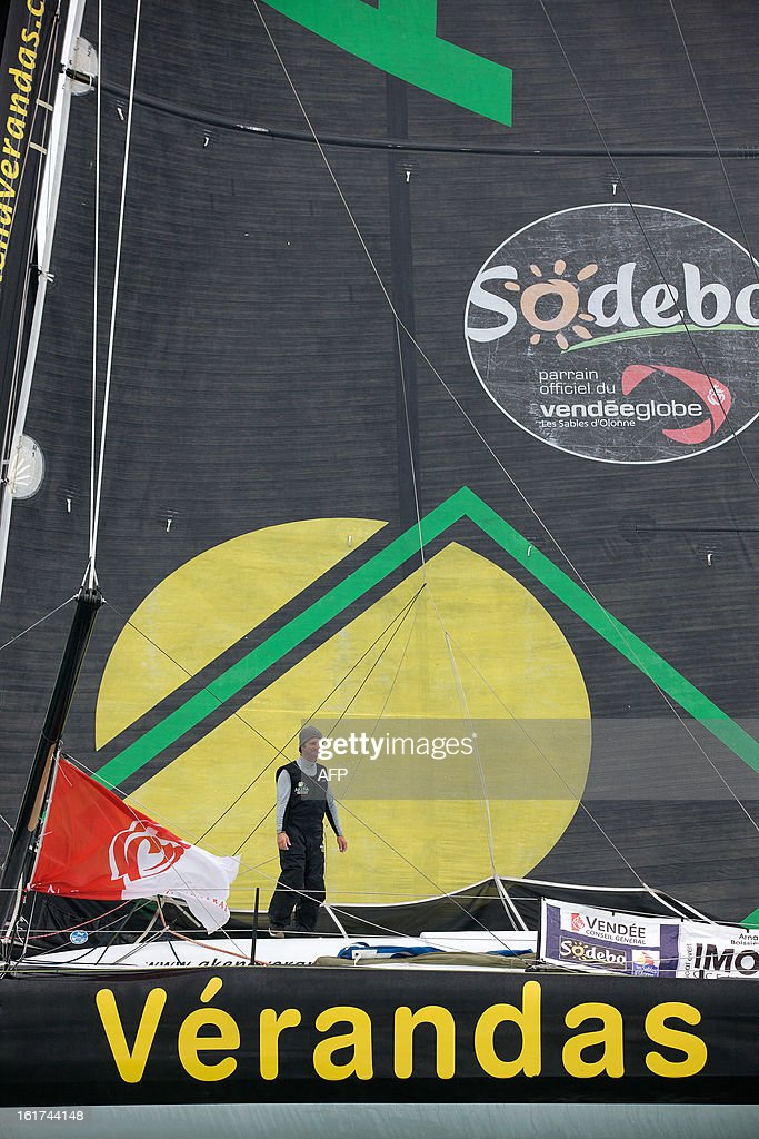 French skipper Arnaud Boissieres celebrates on his monohull 'Akena Verandas' as he finished eighth in the 7th edition of the Vendee Globe solo round-the-world race on February 9, 2013 in Les Sables-d'Olonne, western France. AFP PHOTO / JEAN MARIE LIOT/ DPPI
