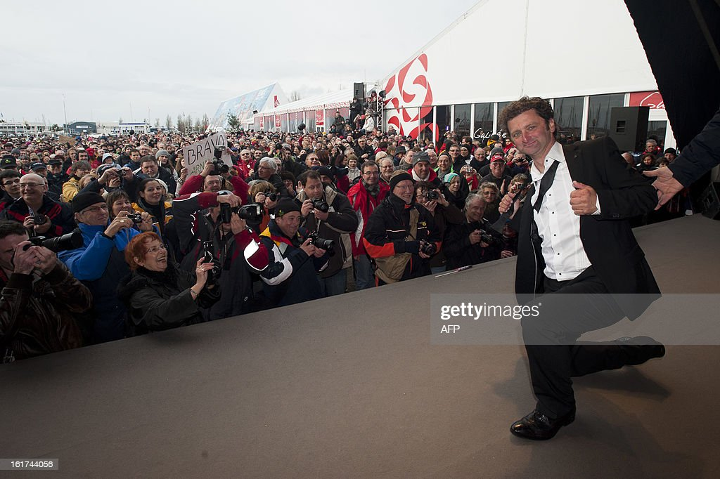 French skipper Arnaud Boissieres celebrates on stage after he finished eighth in the 7th edition of the Vendee Globe solo round-the-world race on February 9, 2013 in Les Sables-d'Olonne, western France.