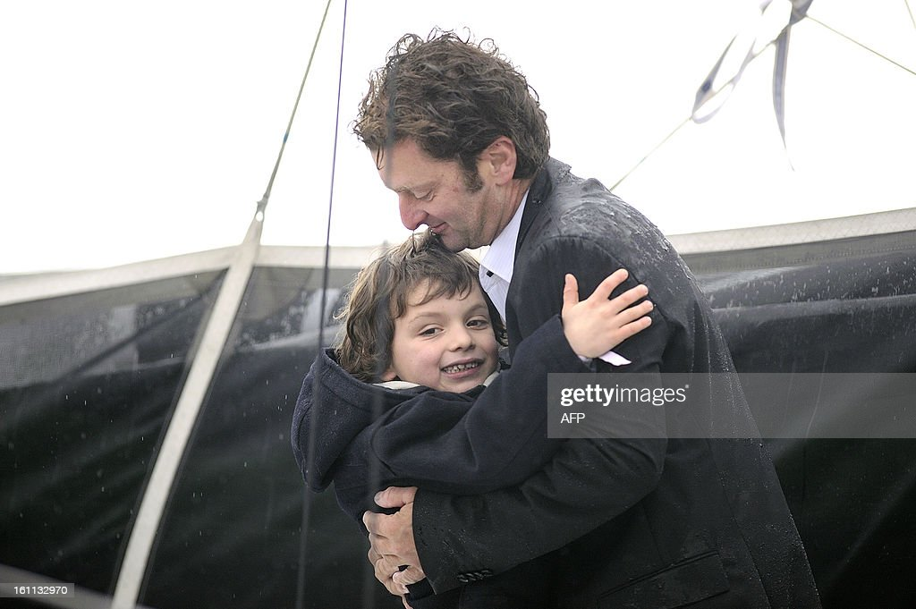 French skipper Arnaud Boissieres celebrates with his son as he finished eighth in the 7th edition of the Vendee Globe solo round-the-world race on February 09, 2013 in Les Sables d'Olonne, western France.