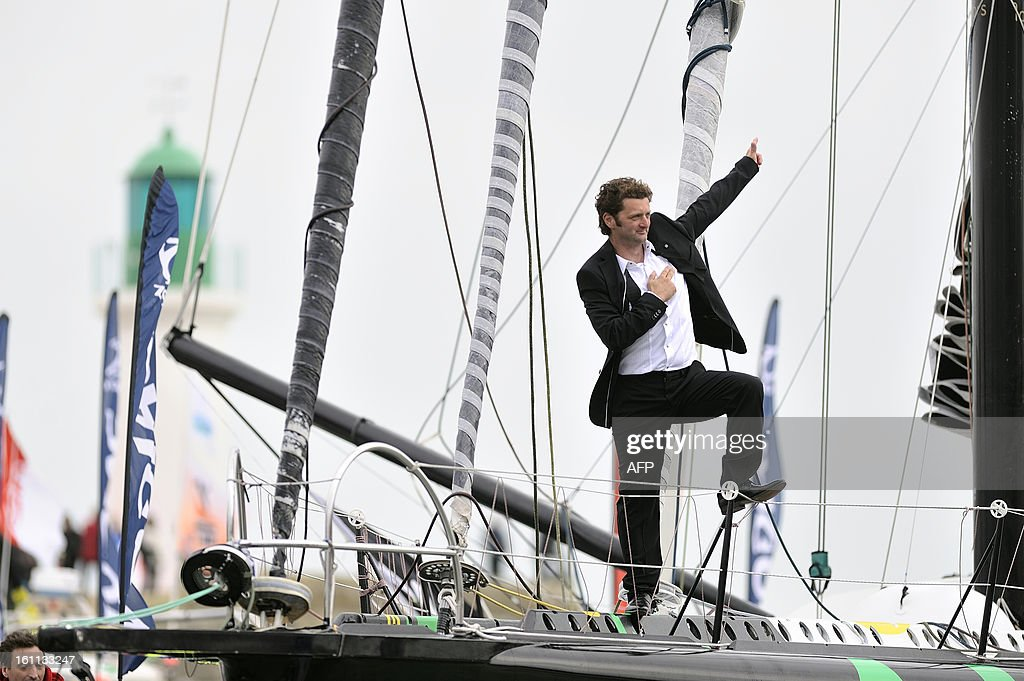 French skipper Arnaud Boissieres gestures as he celebrates on his monohull 'Akena Verandas' as he finished eighth in the 7th edition of the Vendee Globe solo round-the-world race on February 09, 2013 in Les Sables d'Olonne, western France.