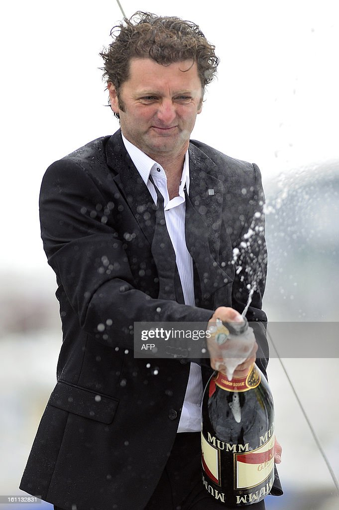 French skipper Arnaud Boissieres sprays champagne as he celebrates on his monohull 'Akena Verandas' as he finished eighth in the 7th edition of the Vendee Globe solo round-the-world race on February 9, 2013 in Les Sables d'Olonne, western France.