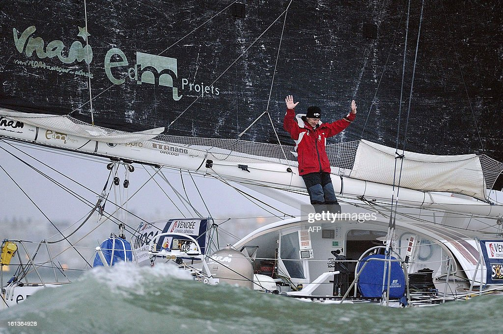 French skipper Bertrand de Broc celebrates on his monohull 'Votre nom autour du monde' as he arrives at Les Sables-d'Olonne after placing ninth of the 7th edition of the Vendee Globe solo round-the-world race on February 10, 2013.