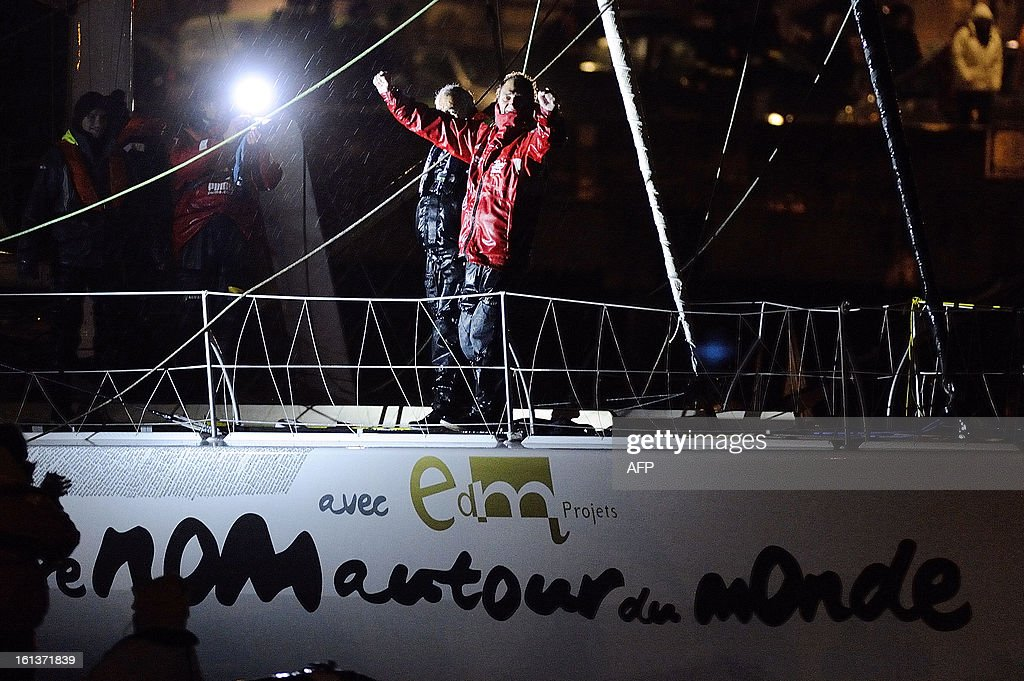 French skipper Bertrand de Broc celebrates on his monohull 'Votre nom autour du monde' as he arrives at Les Sables-d'Olonne after placing ninth of the 7th edition of the Vendee Globe solo round-the-world race on February 10, 2013. AFP PHOTO JEAN-SEBASTIEN EVRARD