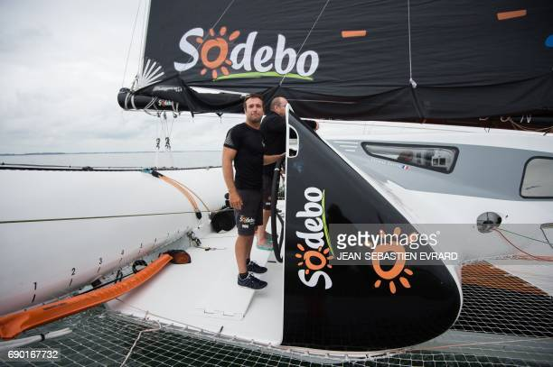 French skipper Billy Besson sails aboard the multihull 'Sodebo Ultim' of Thomas Coville on May 30 2017 off La TrinitesurMer western France Coville...