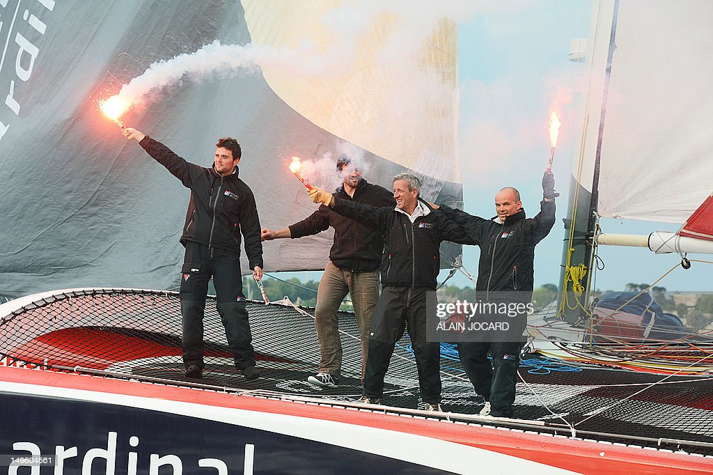 French skipper erwan le roux celebrates with sponsor for Fenetre a cardinal
