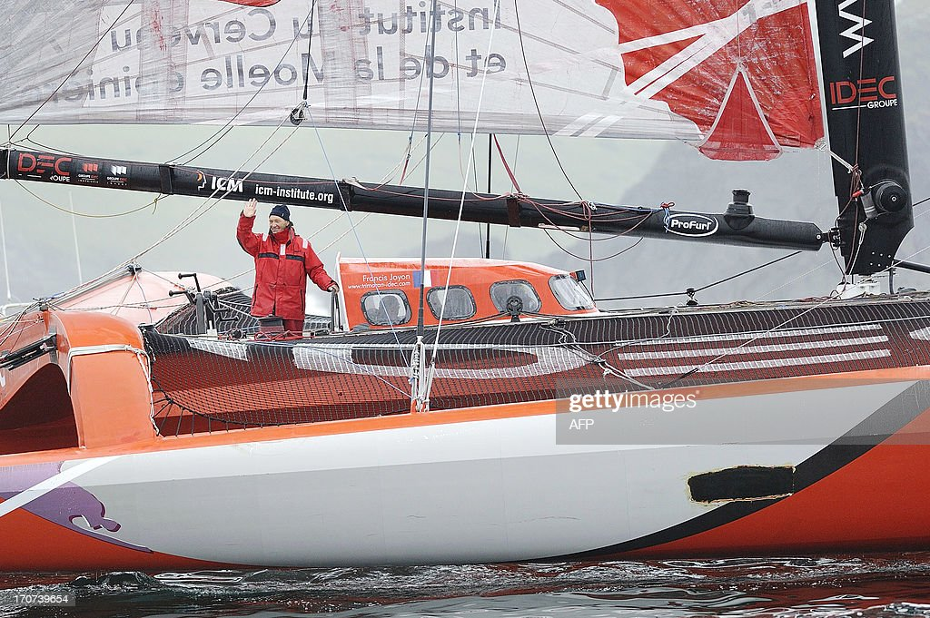 French skipper Francis Joyon is seen on his multihull IDEC upon his arrival at Brest harbour on June 17, 2013, western France, while becoming the fastest man to cross the Atlantic Ocean single-handed on a multihull in 5 days, 2 hours, 56 minutes and 10 seconds, beating the previous record by French skipper Thomas Coville. AFP PHOTO / JEAN-SEBASTIEN EVRARD
