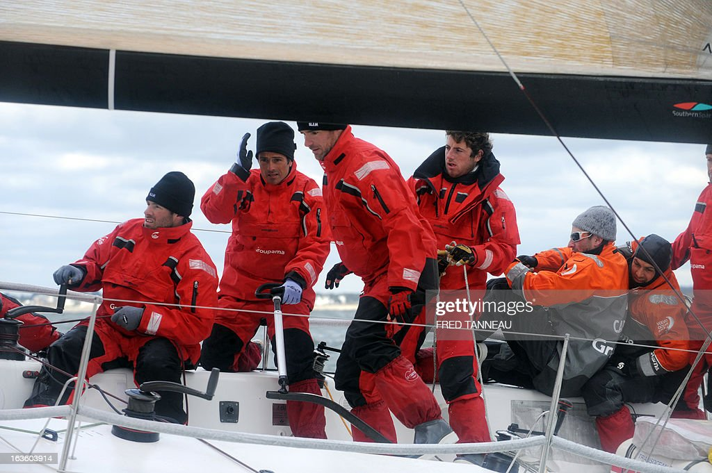 French skipper Franck Cammas (2nd L) and his crew train on Groupama, an M34, a 13,34 meter single-hull, on March 12, 2013 off the coast of Quiberon, Brittany. Cammas is on all fronts, multiplying races and boat categories from the sailing Tour de France to the International Catamaran Challenge Trophy, better known as the Little America's Cup, and a selection for the 2016 Olympic Games.