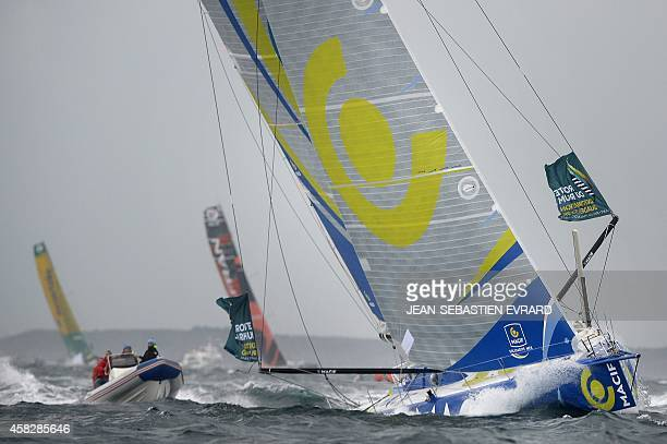 French skipper Francois Gabart aboard 'Macif' and French skipper Marc Guillemot aboard 'Safran' take the start of the 10th edition of the Route du...