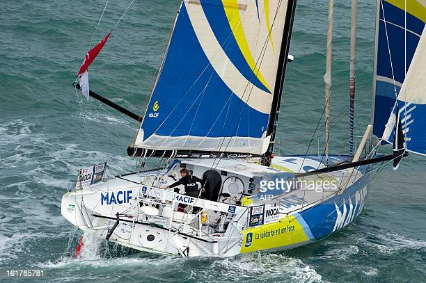 French skipper Francois Gabart arrives aboard his boat 'Macif' after winning the 7th edition of the Vendee Globe solo roundtheworld race on January...