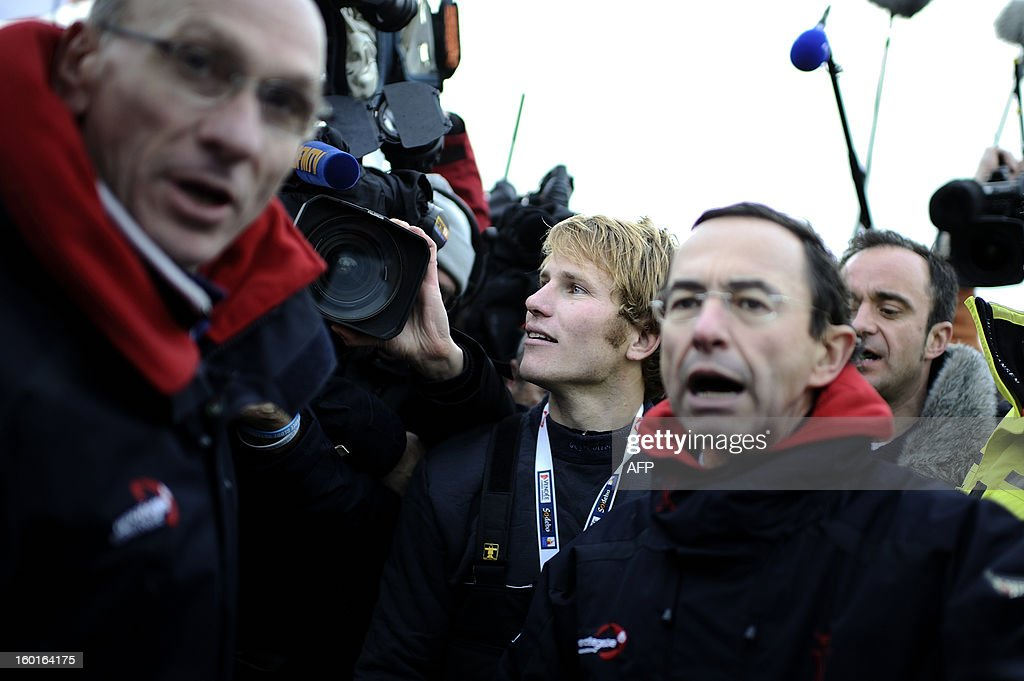 French skipper François Gabart lands (C) after winning the 7th edition of the Vendee Globe solo round-the-world race on January 27, 2013 in Les Sables d'Olonne, western France. Gabart, 29, is the youngest skipper in the event. He set a new record with 78 days 02 h and 16 min, beating the previous record time set at 84 days 3hr 9min by 2009 winner Michel Desjoyeaux. AFP PHOTO JEAN-SEBASTIEN EVRARD