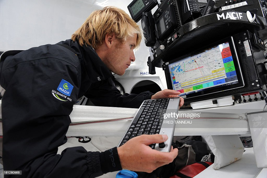 French skipper François Gabart looks at a map during a training aboard the monohull 'Macif' on September 19, 2013 off the coast of Lorient, western of France, as part of his preparation for the Transat Jacques Vabre. The 11th edition of the Transat Jacques Vabre will start from French northwestern city of Le Havre on November 3, 2013 to Brazilian city of Itajai. Fourty-four teams are engaged in four categories (Class40, Imoca, Multi50 et MOD70).