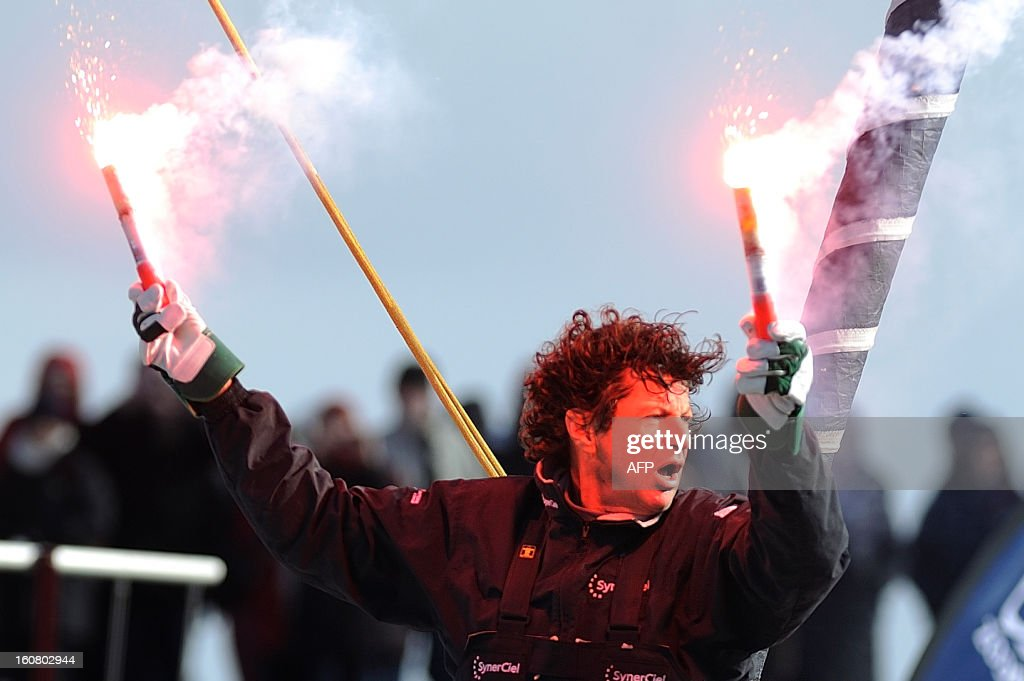 French skipper Jean Le Cam celebrates on his monohull 'SynerCiel' upon his arrival at the 7th edition of the Vendee Globe solo round-the-world race on February 6, 2013 in Les Sables d'Olonne, western France. Le Cam finished in 5th position after 88 days at sea. AFP PHOTO /JEAN-SEBASTIEN EVRARD