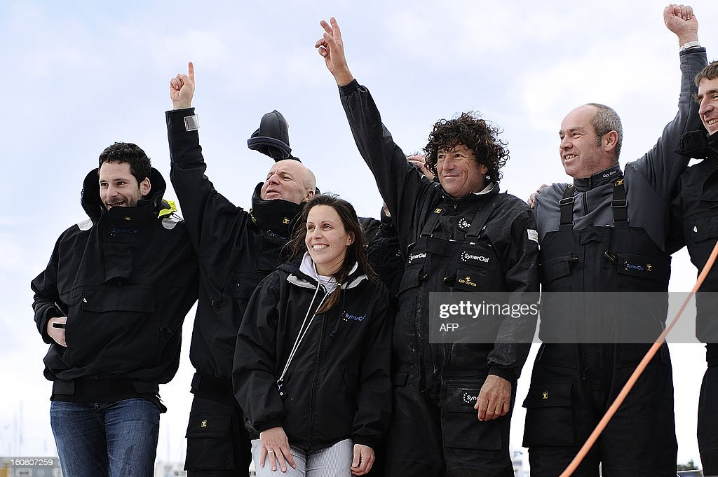 French skipper Jean Le Cam (4thL) celebrates with his with teammates on his monohull 'SynerCiel' upon his arrival at the 7th edition of the Vendee Globe solo round-the-world race on February 6, 2013 in Les Sables d'Olonne, western France. Le Cam finished in 5th position after 88 days at sea.