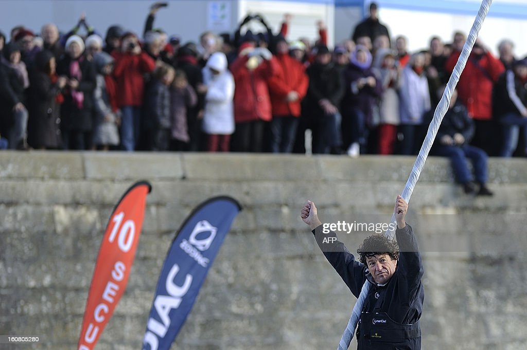 French skipper Jean Le Cam gestures as he celebrates on his monohull 'SynerCiel' upon his arrival at the 7th edition of the Vendee Globe solo round-the-world race on February 6, 2013 in Les Sables d'Olonne, western France. Le Cam finished in 5th position after 88 days at sea.