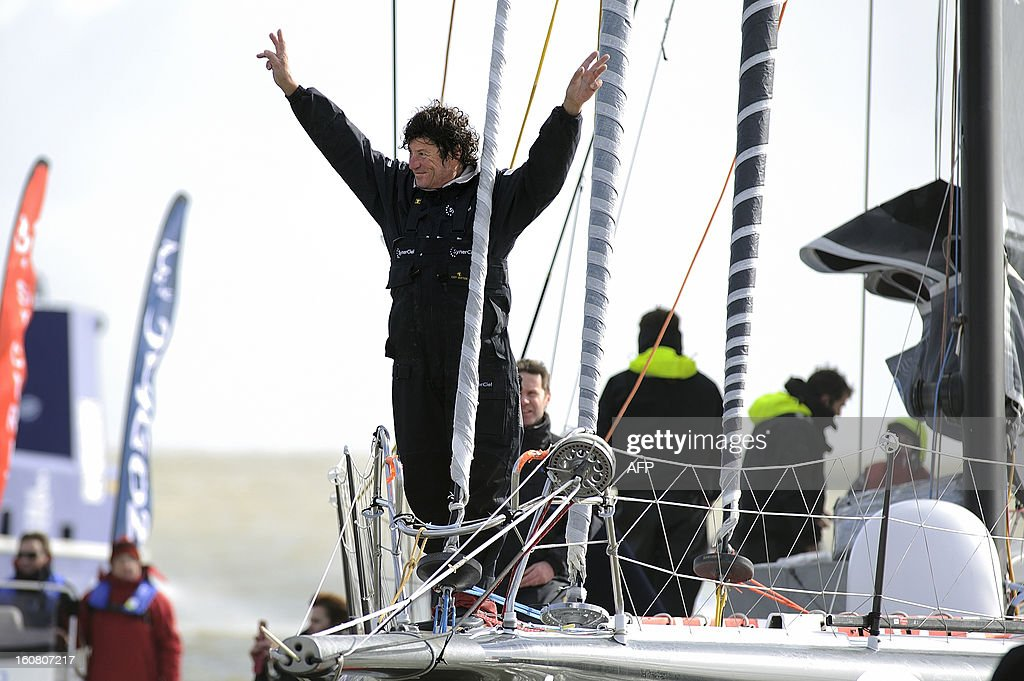 French skipper Jean Le Cam gestures as he celebrates on his monohull 'SynerCiel' upon his arrival at the 7th edition of the Vendee Globe solo round-the-world race on February 6, 2013 in Les Sables d'Olonne, western France. Le Cam finished in 5th position after 88 days at sea. AFP PHOTO /JEAN-SEBASTIEN EVRARD