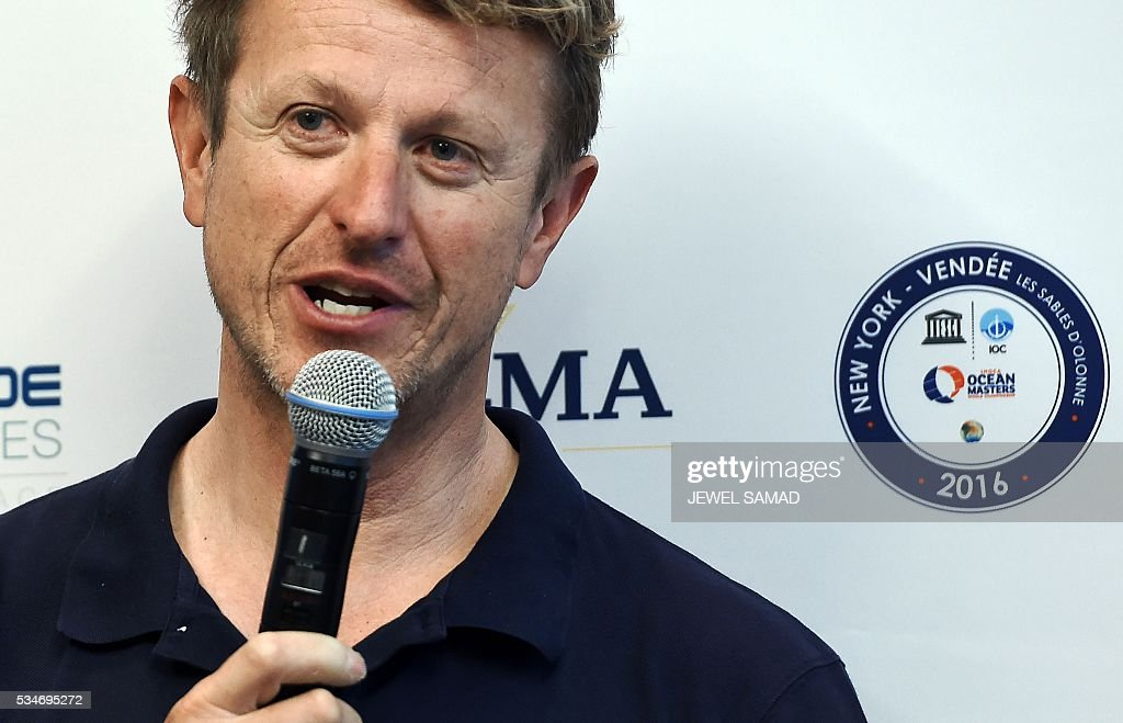 French skipper Jean-Pierre Dick answers a question during a press conference ahead of the New York-Vendee Race, on May 27, 2016 in New York. / AFP / Jewel SAMAD