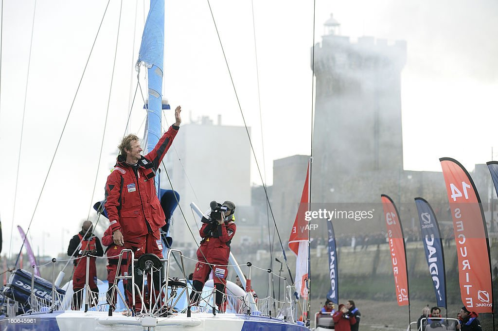 French skipper Jean-Pierre Dick celebrates on his monohull 'Virbac Paprec 3' as he finished fourth in the Vendee Globe solo round-the-world race on February 4, 2013 in Les Sables d'Olonne, western France. Dick sailed without a keel since January 22.