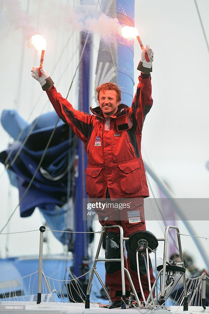 French skipper Jean-Pierre Dick celebrates on his monohull 'Virbac Paprec 3' as he finished fourth in the Vendee Globe solo round-the-world race on February 4, 2013 in Les Sables d'Olonne, western France. Dick sailed without a keel since January 22. AFP PHOTO/ JEAN-SEBASTIEN EVRARD
